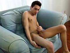 Pierced skinny boy strips and strokes dick