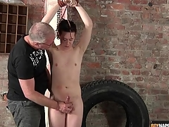 Pretty boy in bondage stroked unconnected with his skillful