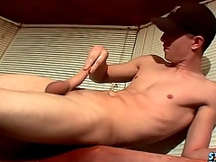 Masturbating dear boy cums on a glass table
