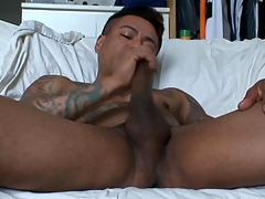 Joyful latino tugs his cock and cums